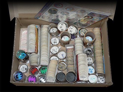 Photo of a box full of Pog swaps, stored in Pogtainers and Pog trays