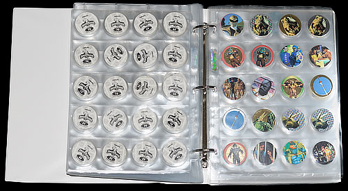 Open folder showing Pogs stored in Collectors Wallets / Storage Sleeves